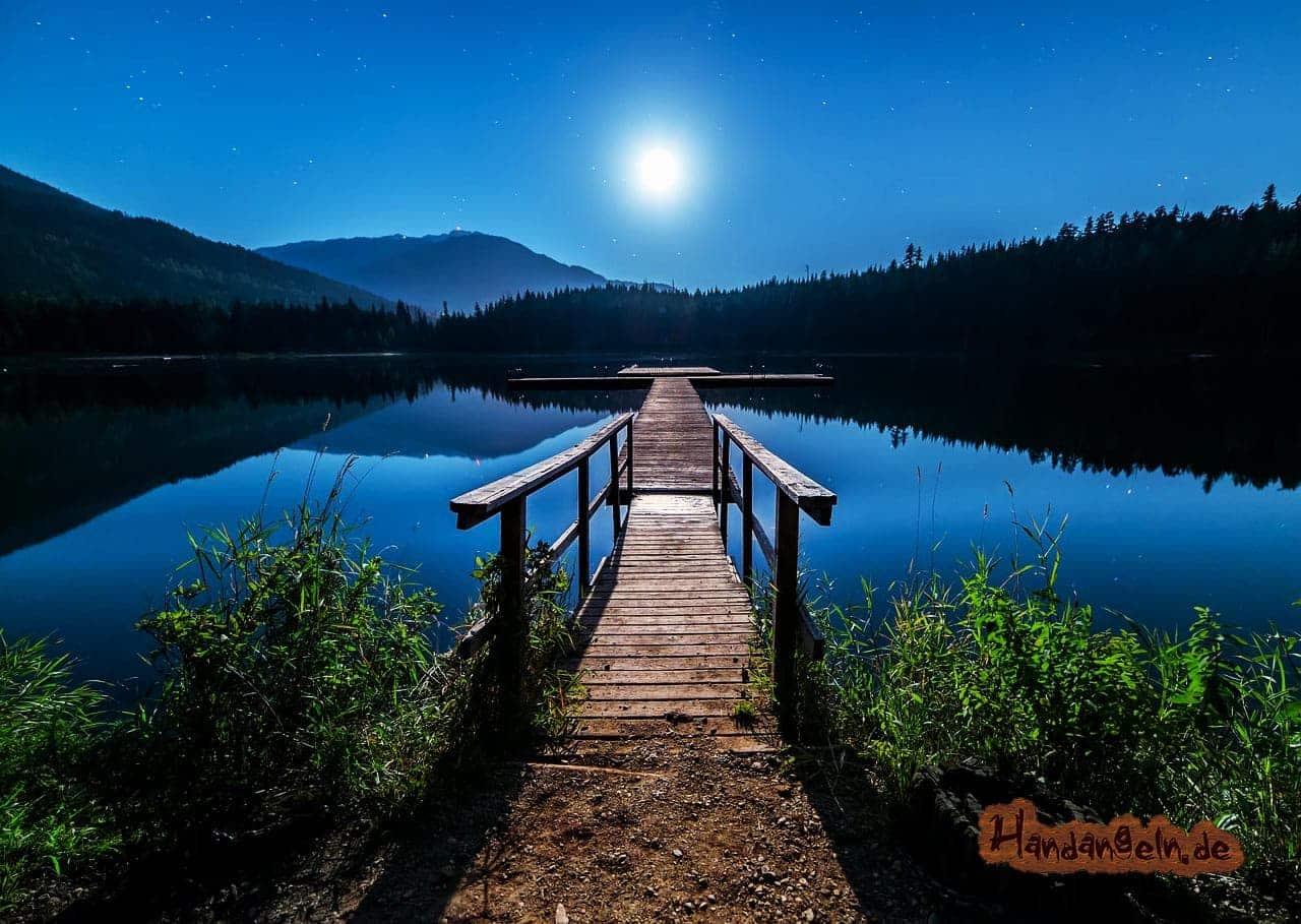 Aalangeln nachts See Steg